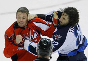 Washington Capitals' Matt Hendricks and Winnipeg Jets' Chris Thorburn fight in the third period of their NHL hockey game in Washington