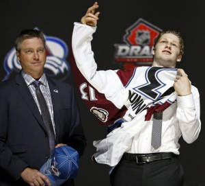 Nathan Mackinnon is selected by the Avalanche as the first overall pick in the 2013 NHL draft in Newark